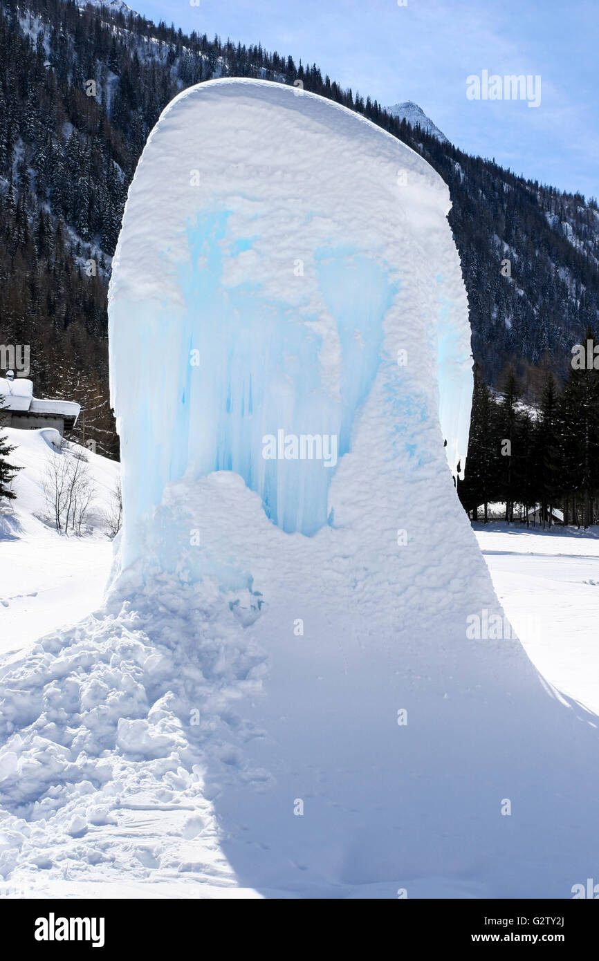 Iced up fountain in the ski resort of Courmayeur, Italy - Stock Image