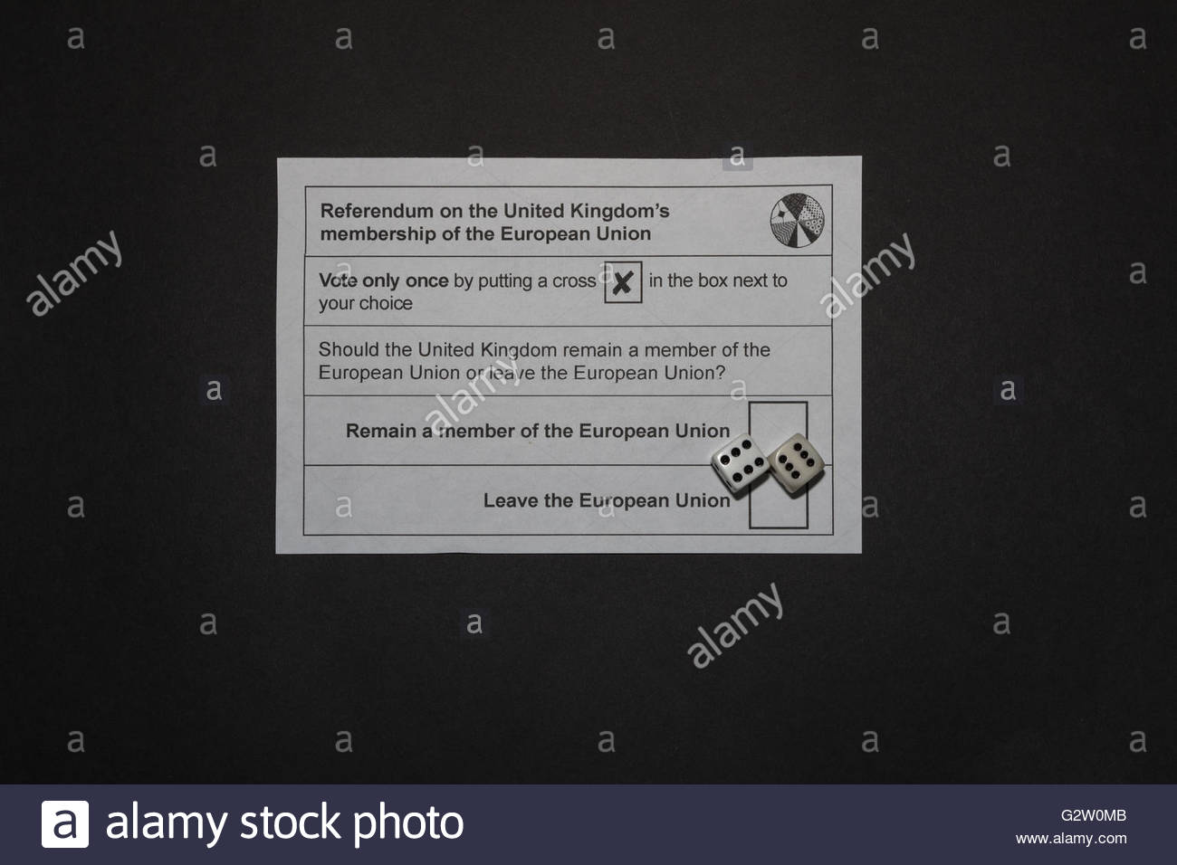 UK EU referendum ballot paper with a pair of dice showing a double six covering the Leave and Remain boxes on a - Stock Image