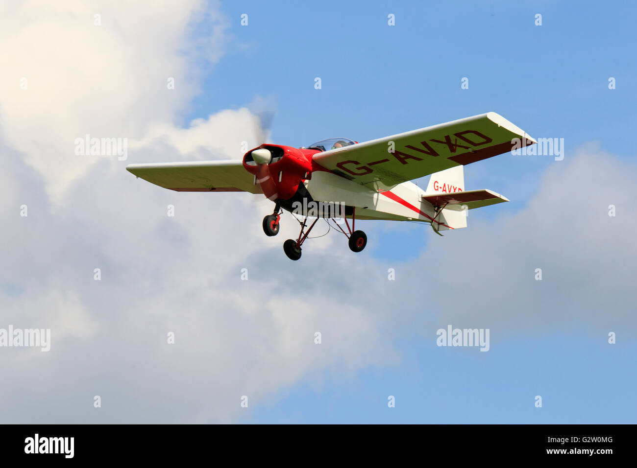 Tipsy (Slingsby) T66 RA45 Series 3 Nipper G-AVXD in flight at North Coates Airfield - Stock Image