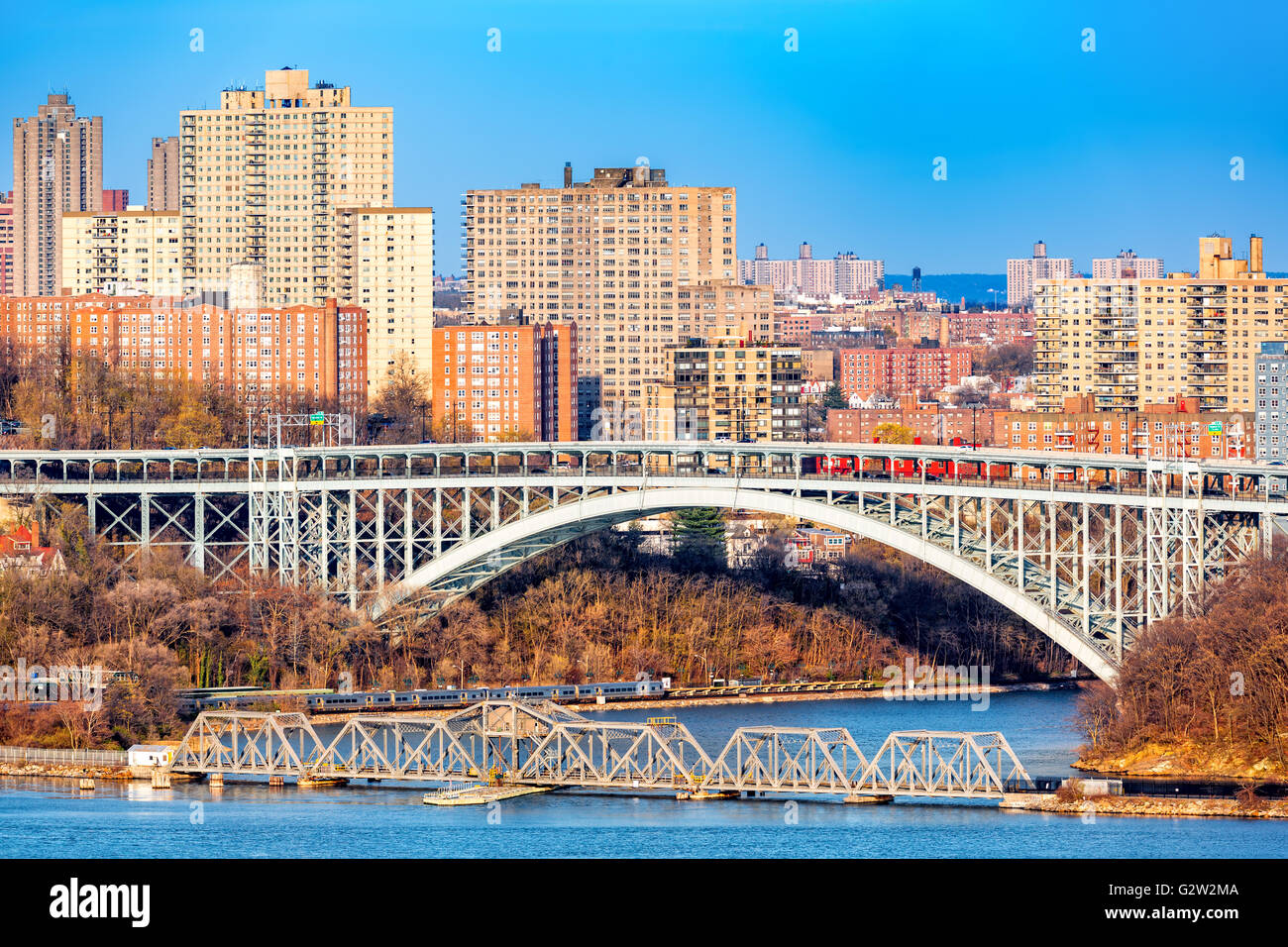 Henry Hudson Bridge spans Spuyten Duyvel Creek, in New York City - Stock Image