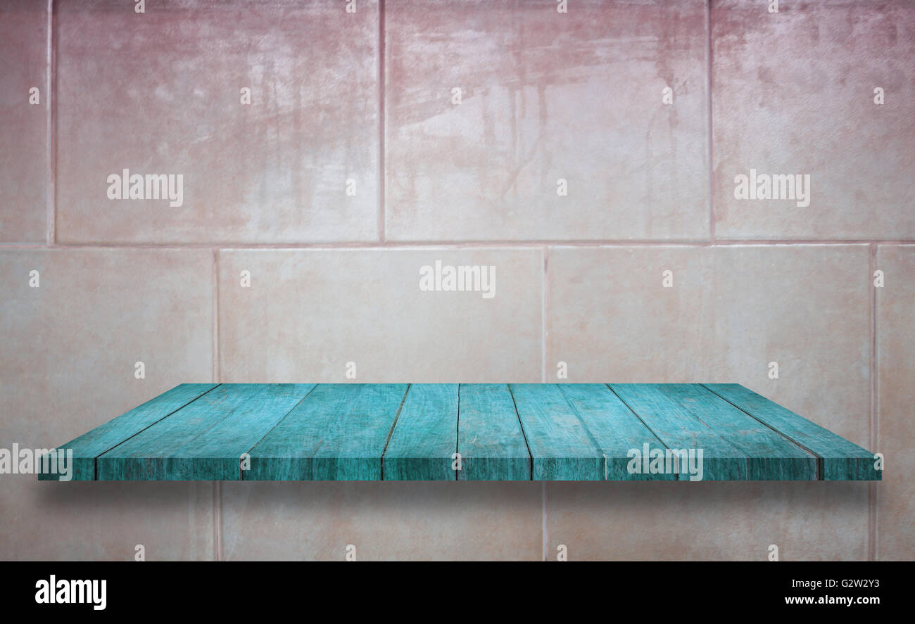 Top of blue wooden shelf on ceramic tiles wall texture background ...