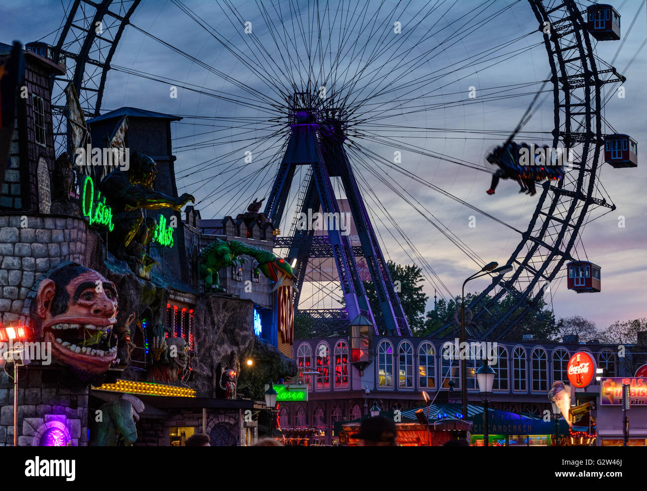 Prater with haunted castle , Ferris wheel and swing ' Tornado ', Austria, Vienna, Wien - Stock Image