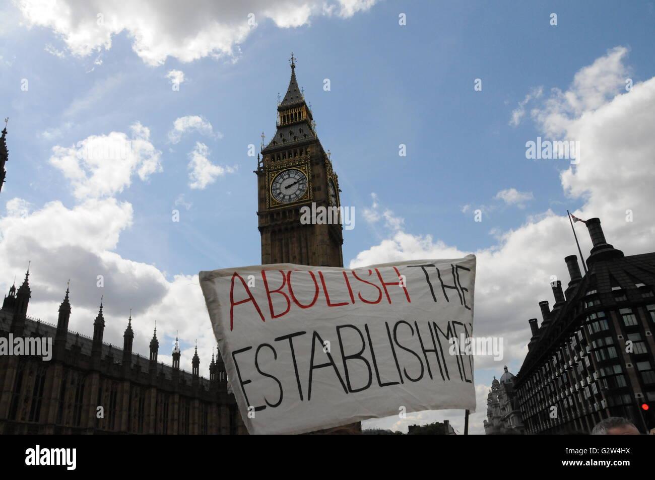 Anti-establishment placard held in front of Big Ben. - Stock Image
