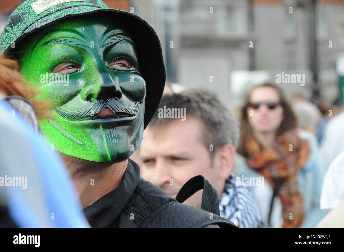 Masked protester at the 2015, Austerity protest on Westminster bridge. - Stock Image