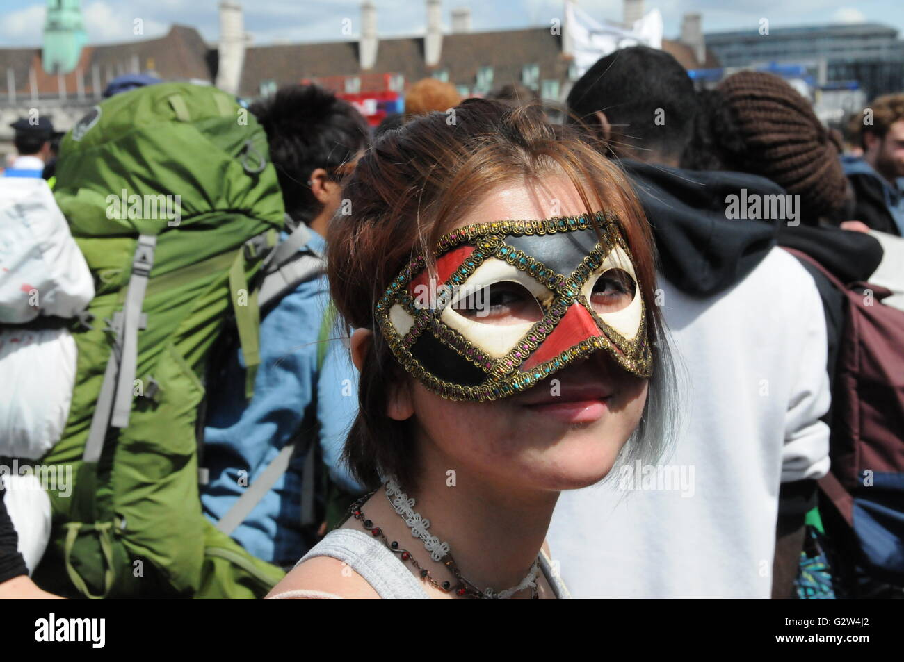 Young girl protester in a leather mask, at the anti austerity protest on Westminster Bridge. - Stock Image
