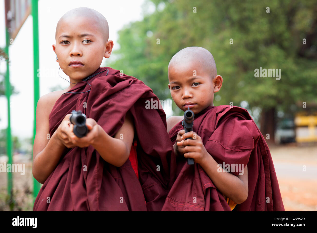 Two young novice monks with toy weapons, Kakku, Shan State, Myanmar - Stock Image