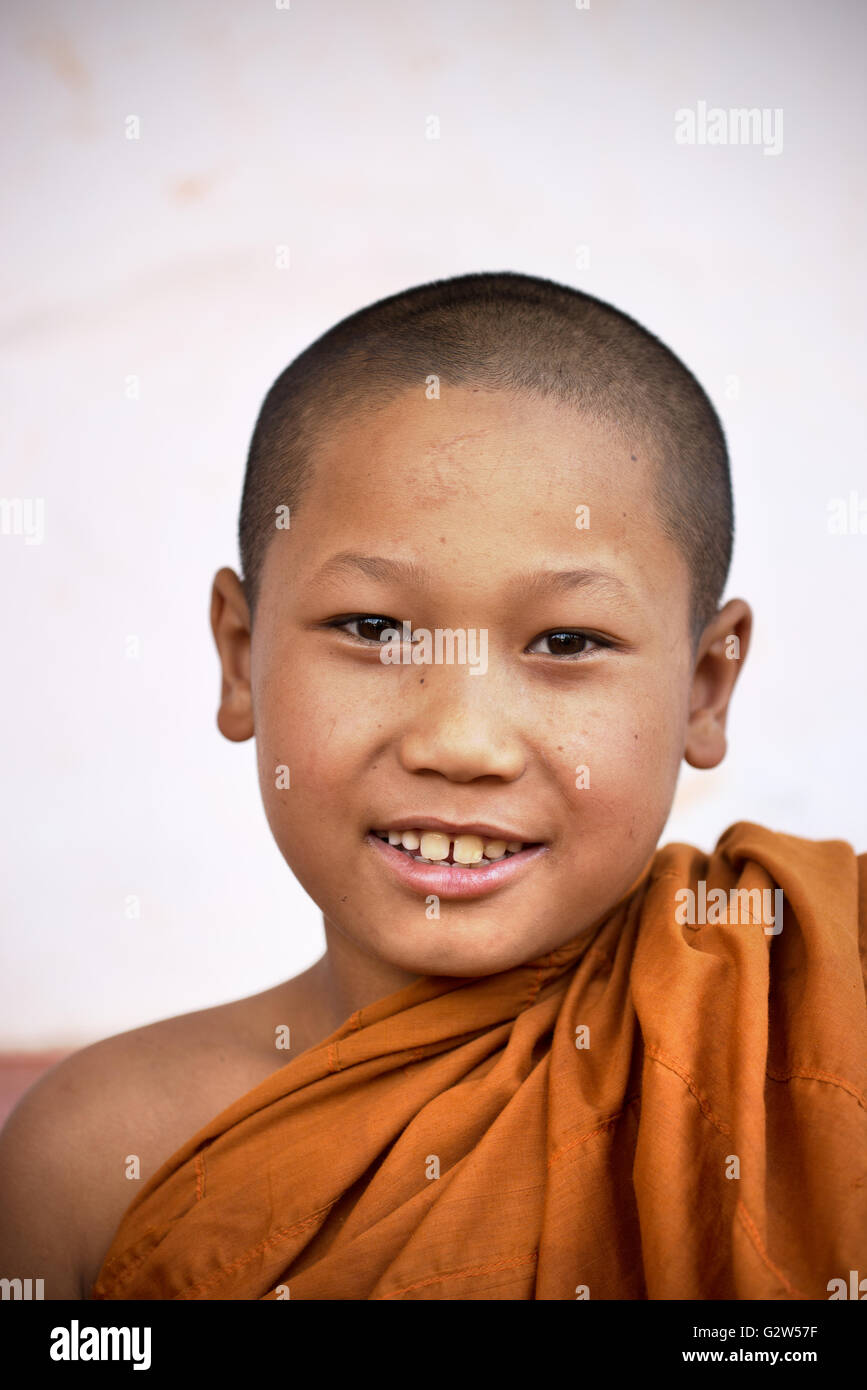 Smiling young novice monk with saffron robe, Shan State, Myanmar - Stock Image