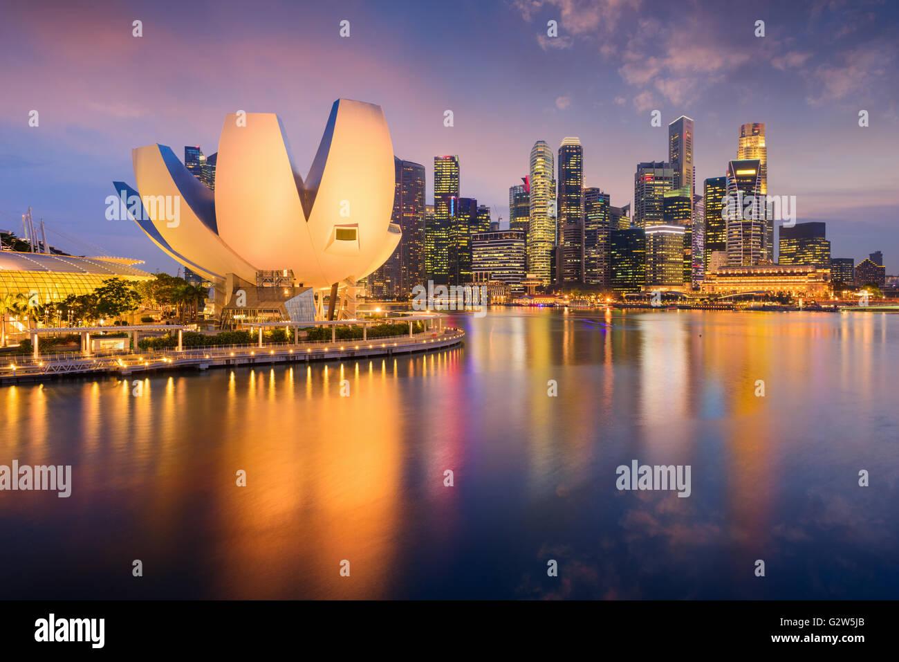 Singapore skyline at the Marina during twilight. - Stock Image