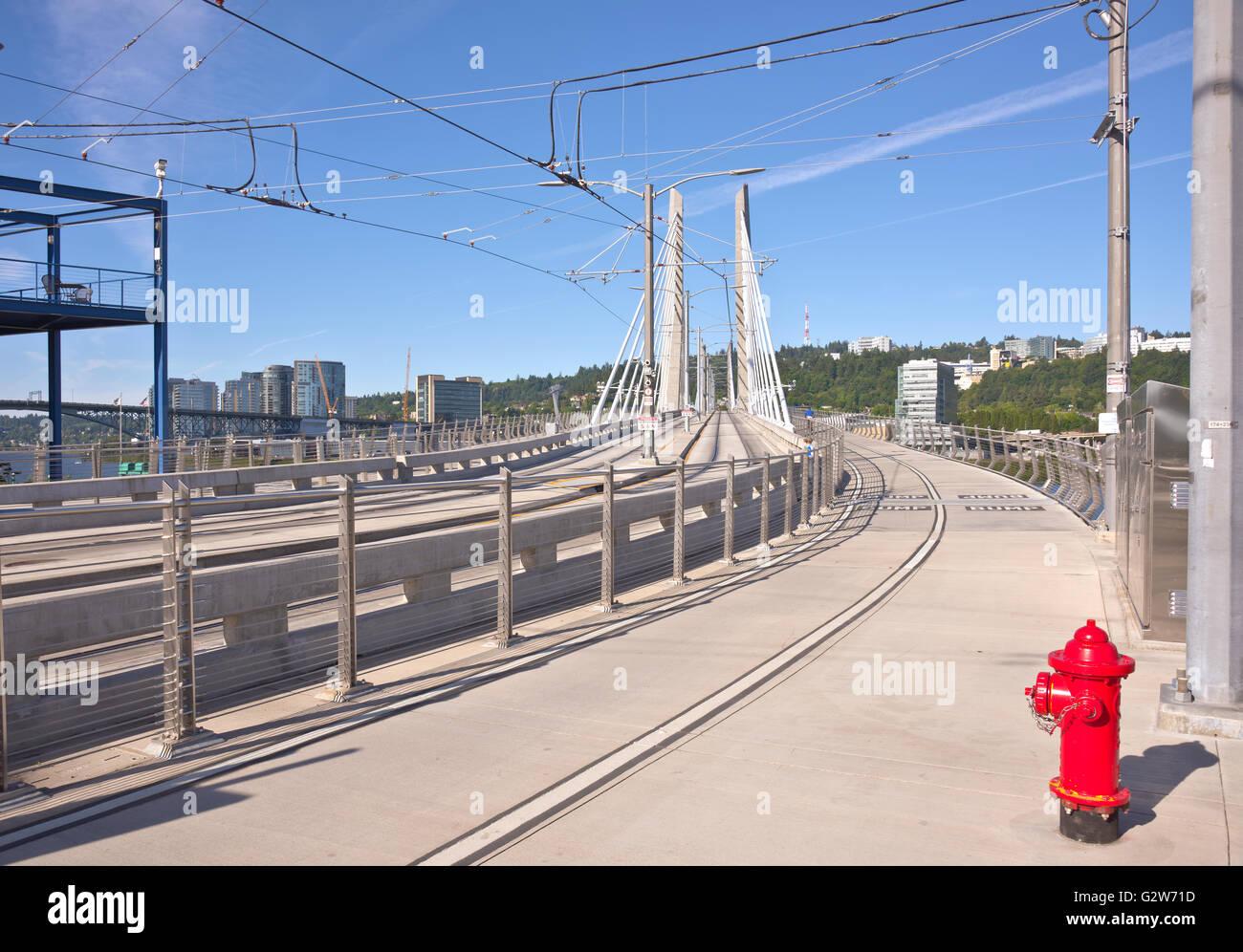 Tillikum crossing bridge and railtracks Portland Oregon. - Stock Image