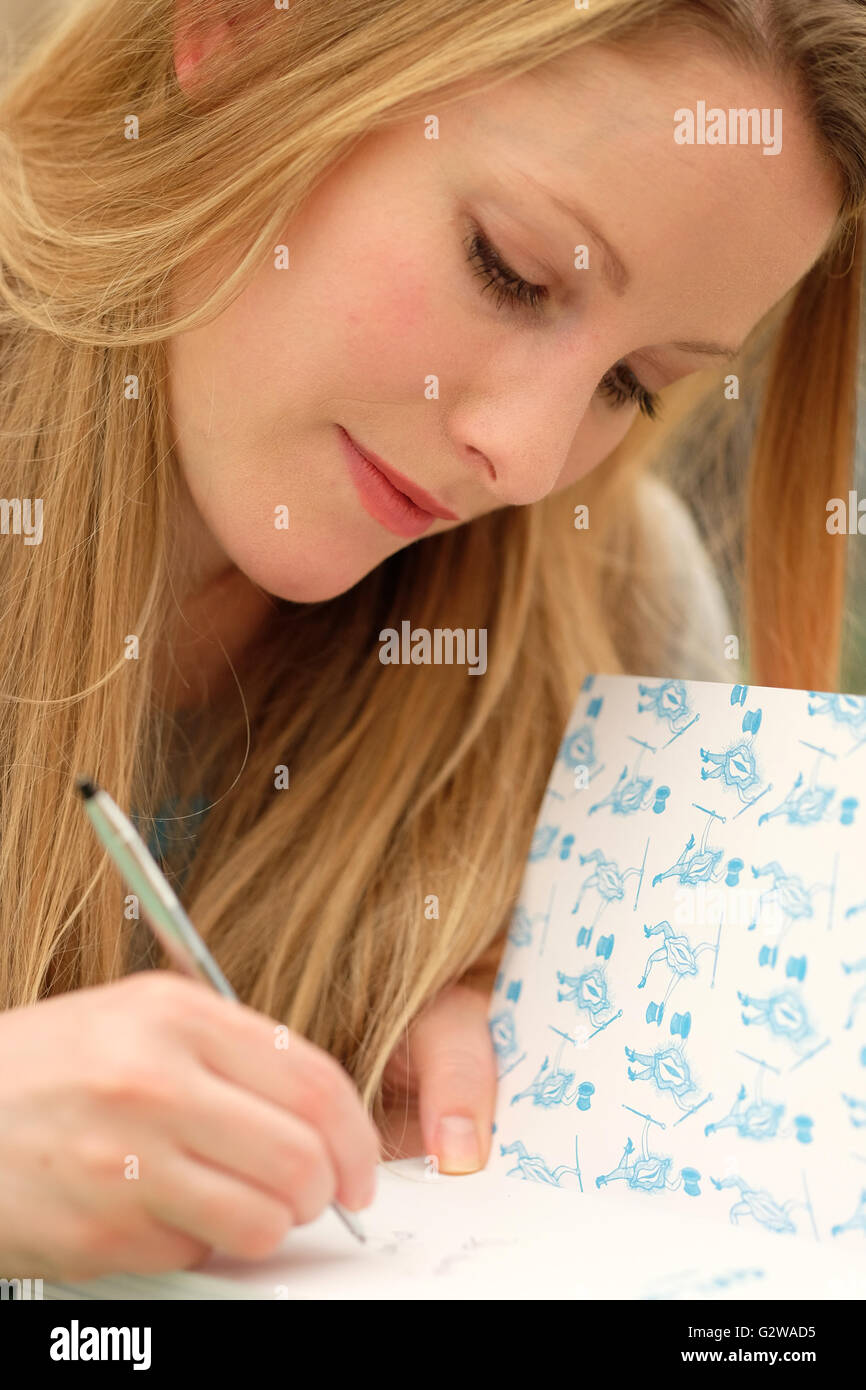 Hay Festival, Wales, UK - June 2016 - Author Laura Bates at her book signing session in the Festival bookshop. She - Stock Image
