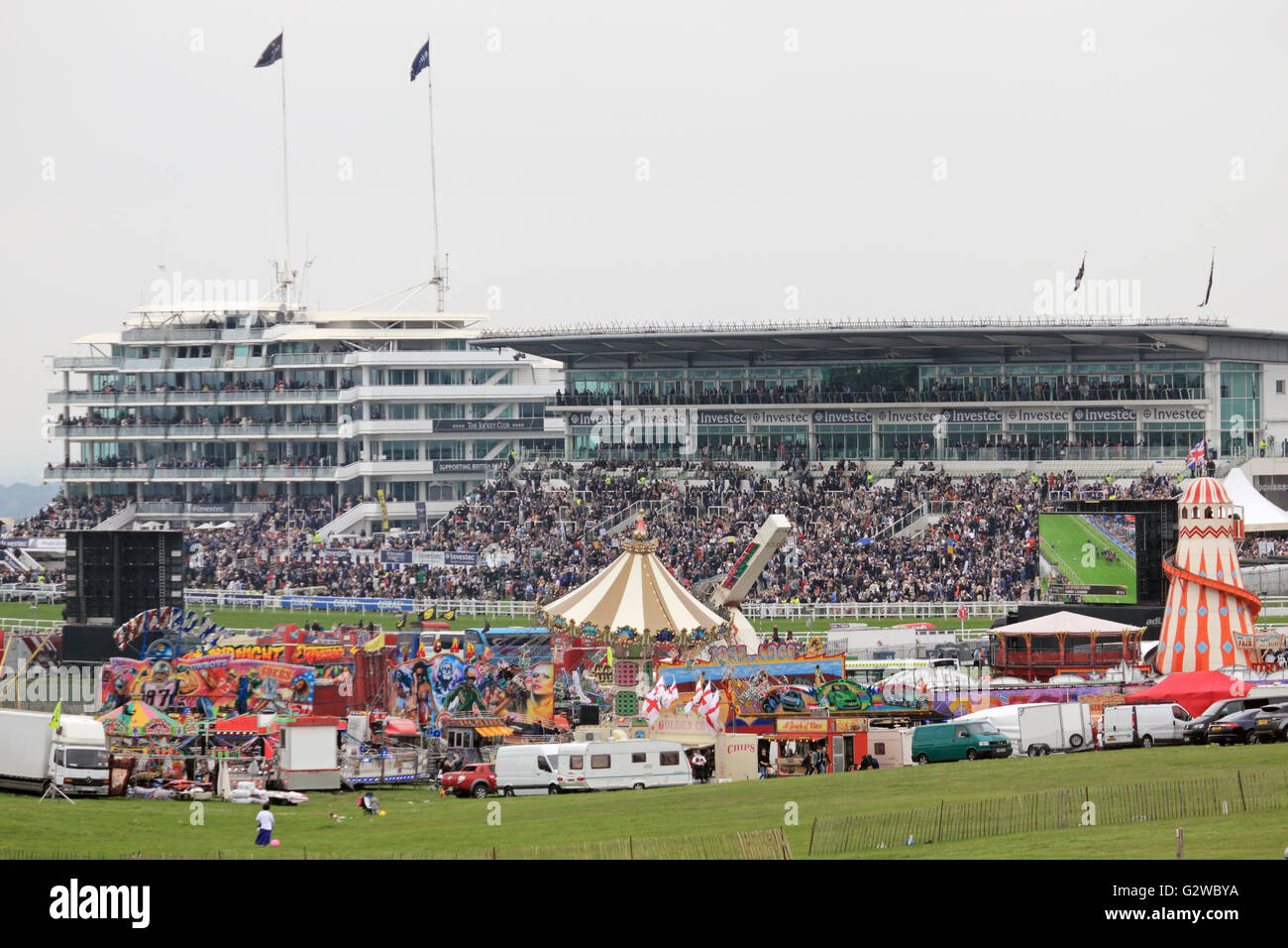 Epsom Downs, Surrey, England, UK. 3rd June 2016. Ladies Day at Epsom Downs race course. The traditional fun fair - Stock Image