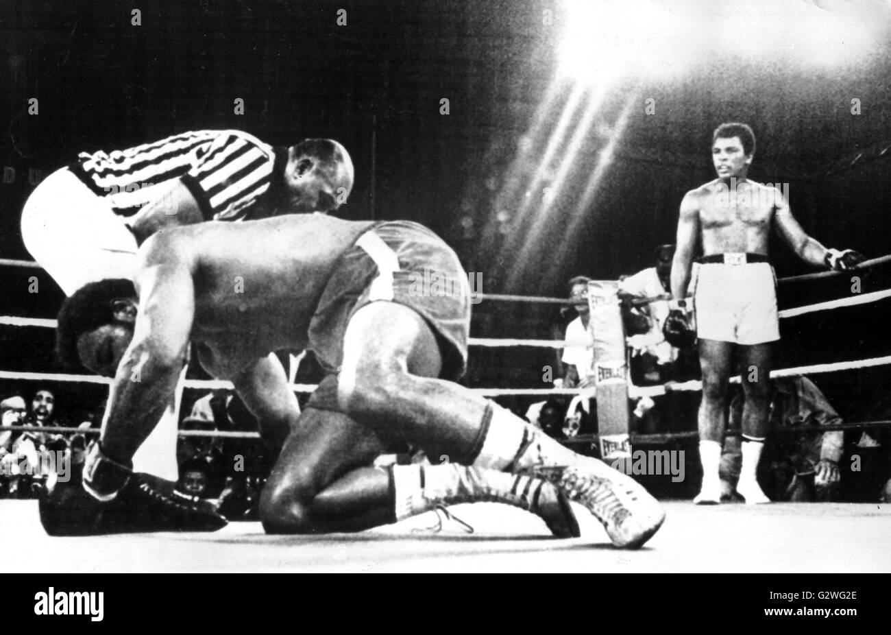 File a file picture dated 30 october 1974 shows us heavyweight boxer muhammad ali back r standing in a corner as his knocked out opponent george foreman