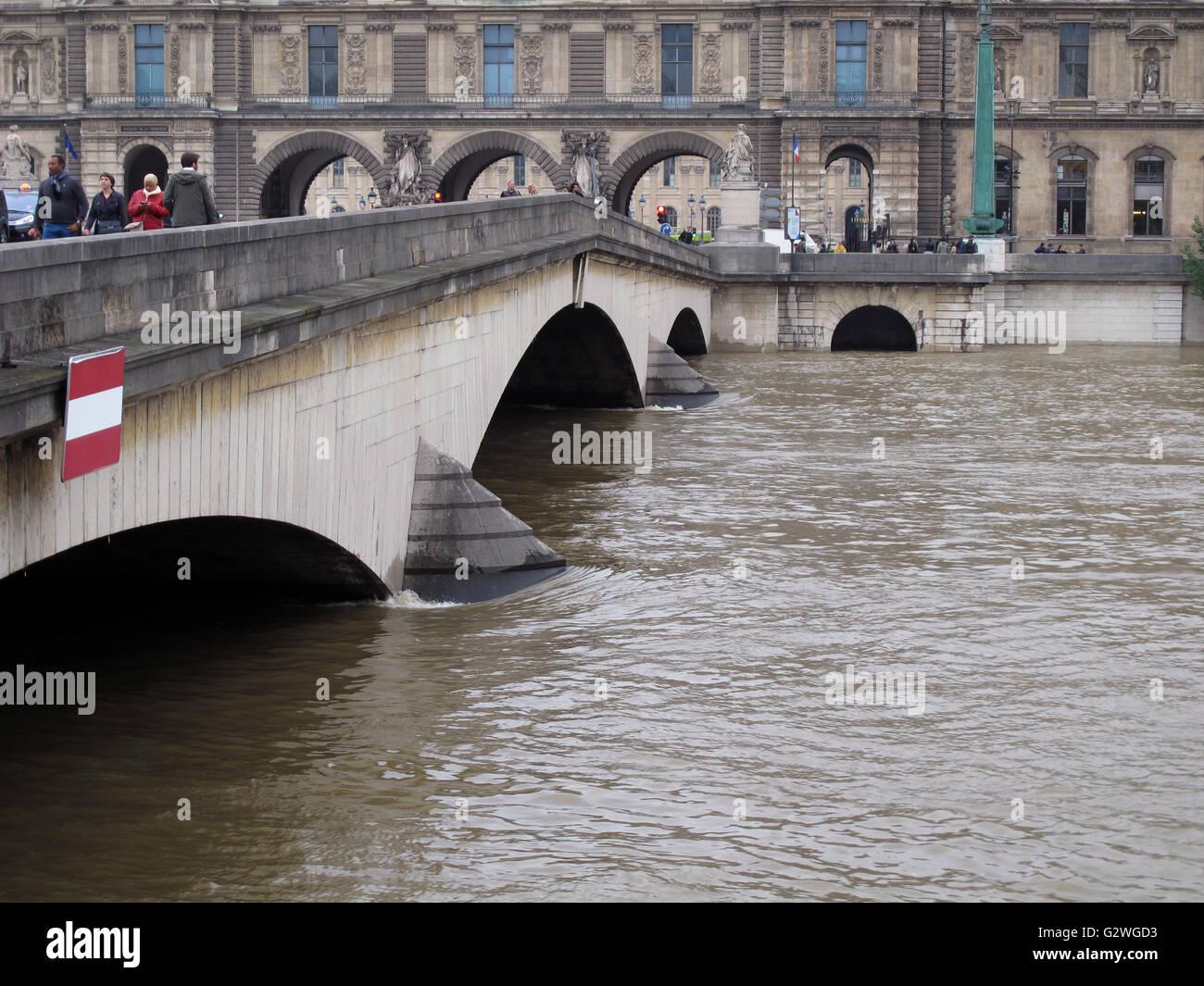 Pont du Carrousel and Louvre museum, flood of the Seine river, June 3, 2016, Paris, France - Stock Image