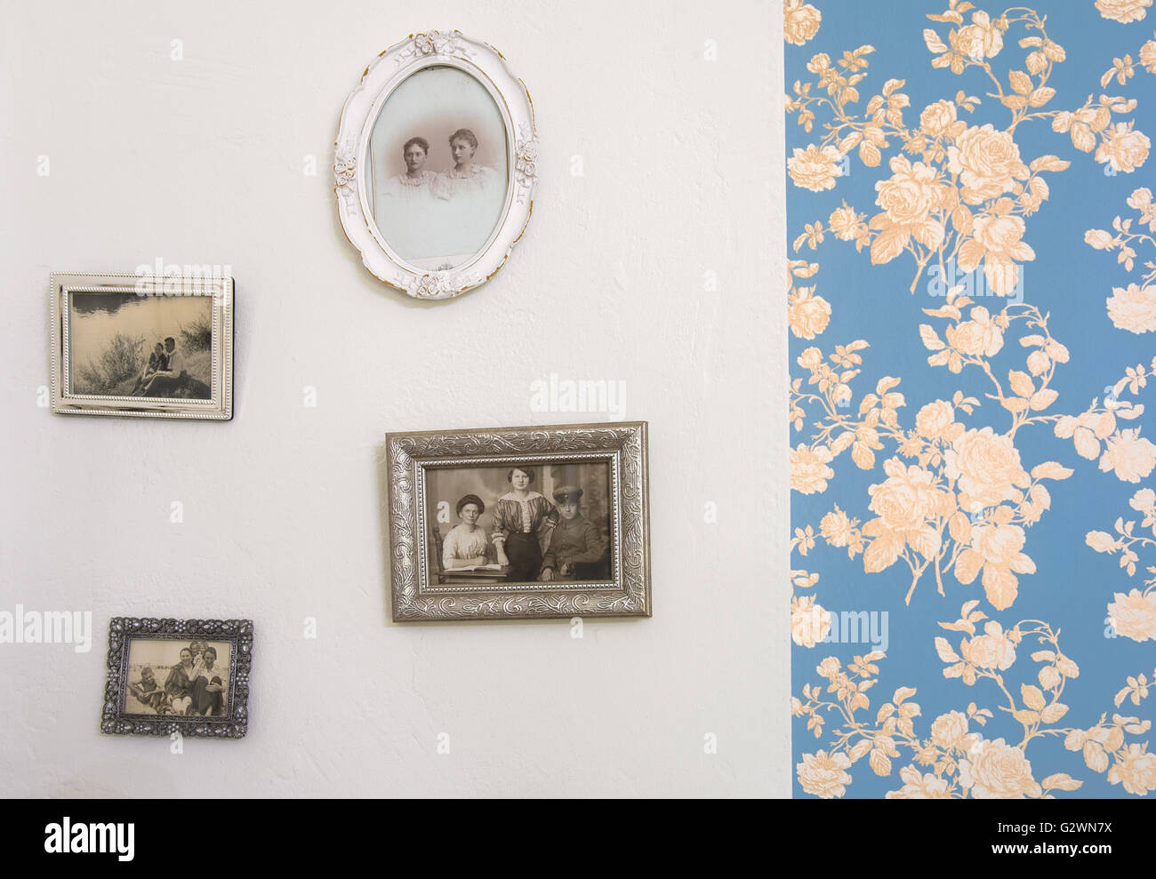 Berlin, Germany, Detail of a wall with historical pictures and Bluemchentapete - Stock Image