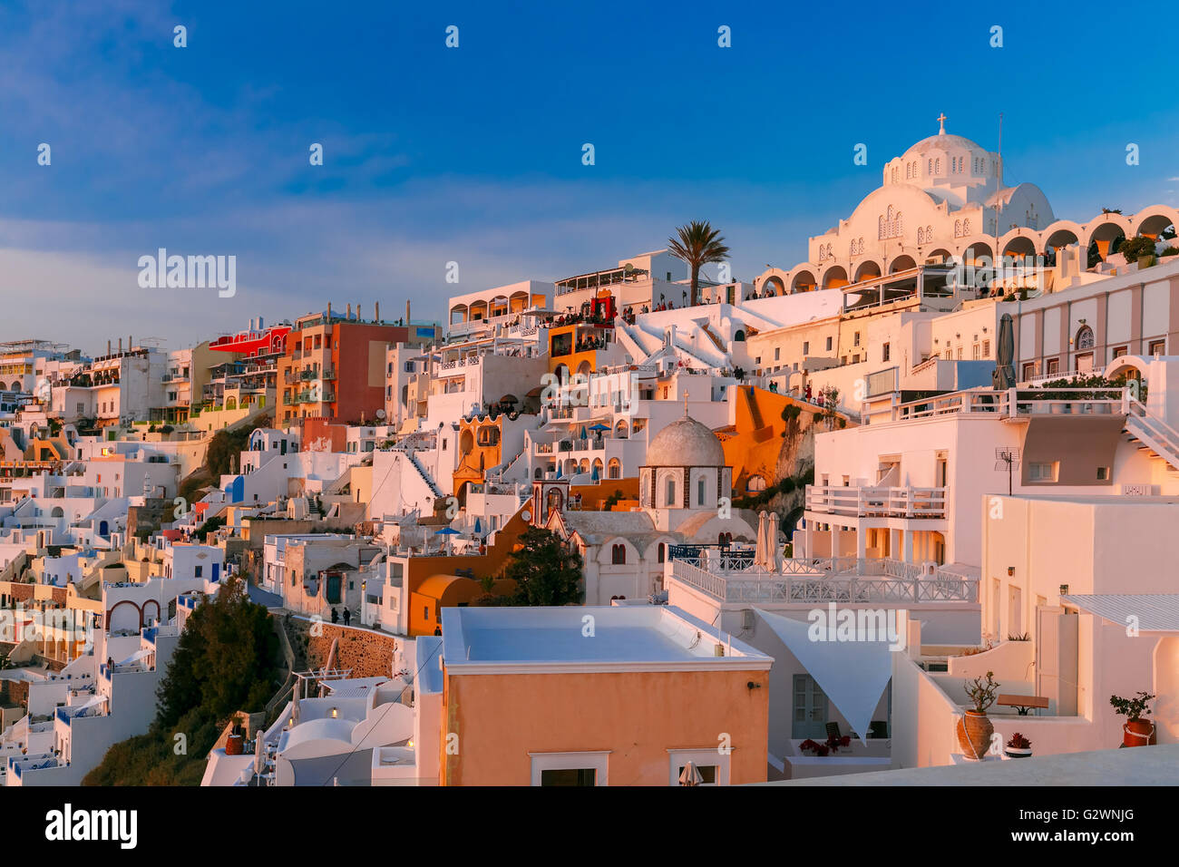 Fira at sunset, Santorini, Greece - Stock Image