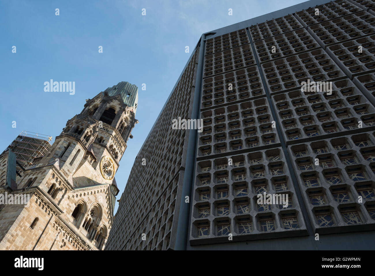 26.10.2015, Berlin, Berlin, Germany - Kaiser Wilhelm Memorial Church, Old Church tower with ruins and part of Eiermann's - Stock Image