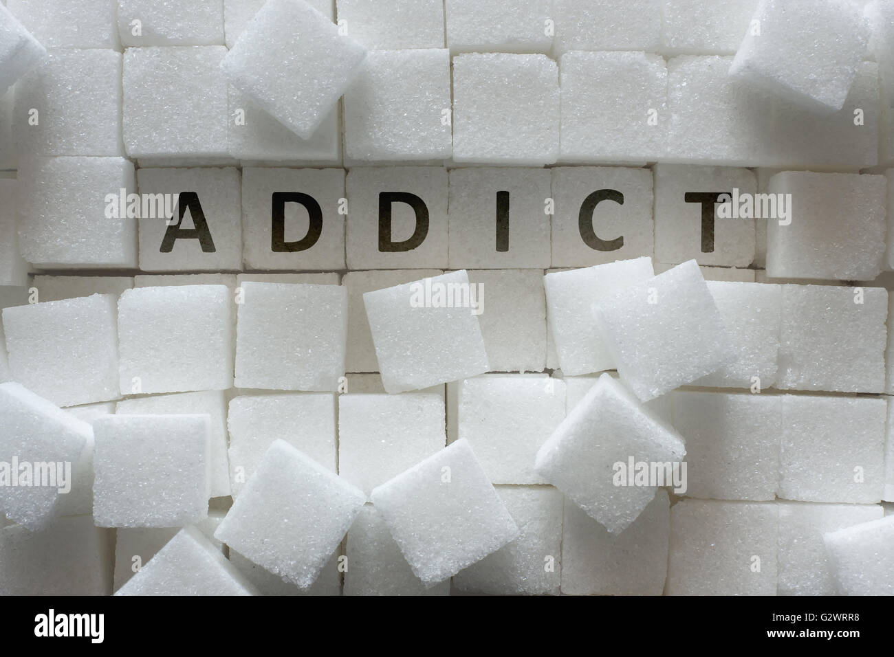 Sugar cubes and 'addict' inscription - Stock Image