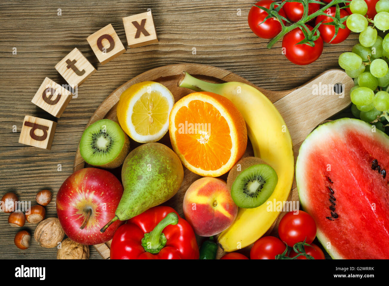 Detox. Vitamins in fruits and vegetables. Natural products rich in vitamins as oranges, lemons, red pepper, kiwi,tomatoes, - Stock Image