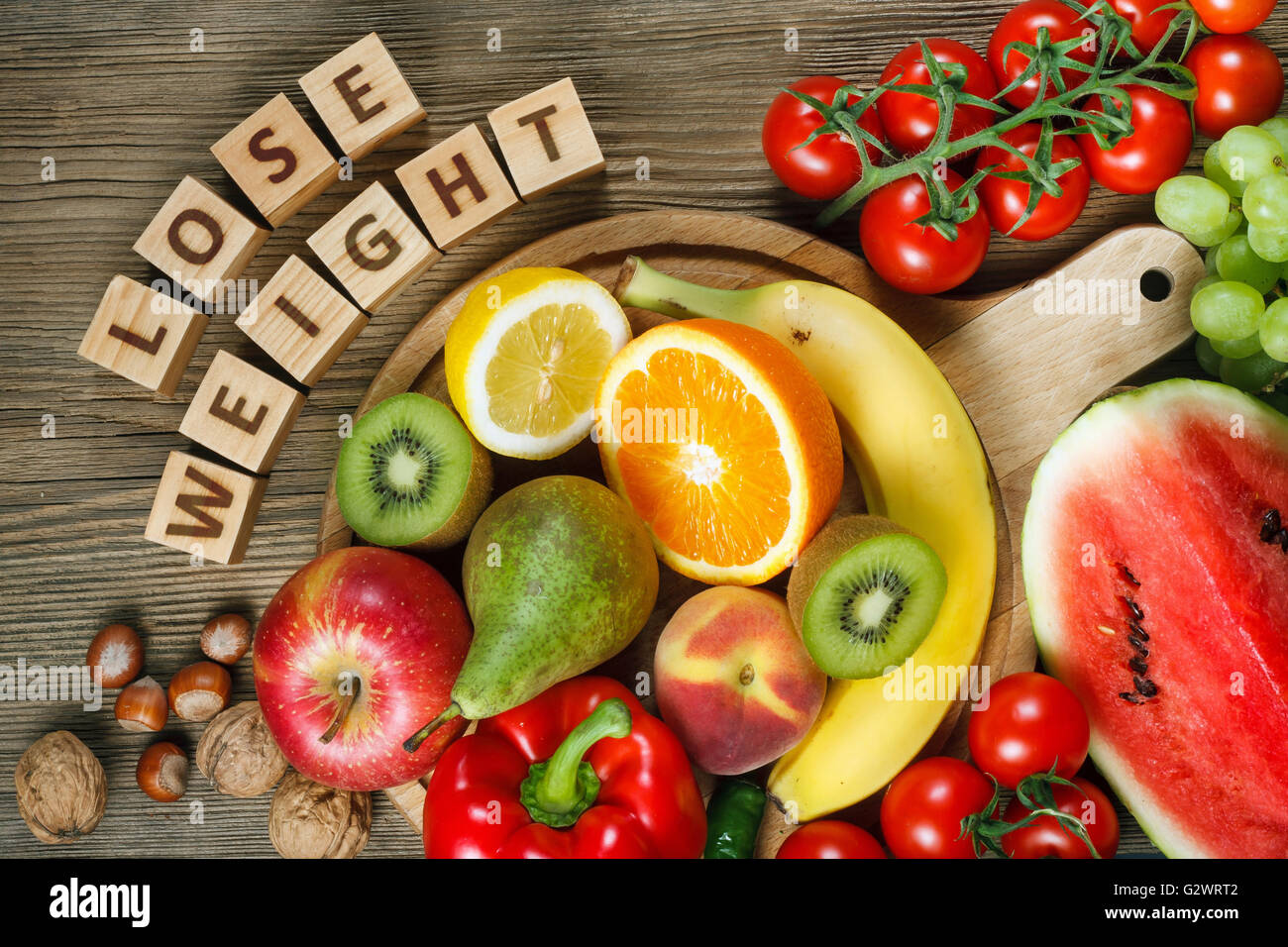 Diet concept. Natural products rich in vitamins as oranges, lemons, red pepper, kiwi, tomatoes, bananas, pears, - Stock Image