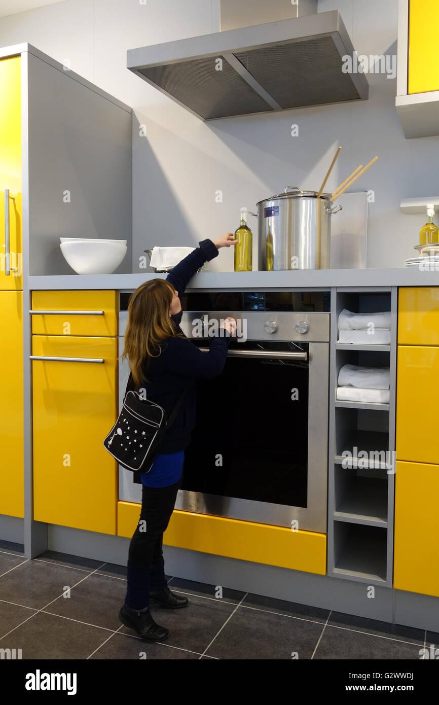 22 02 2014 berlin berlin germany woman stands in an oversized kitchen