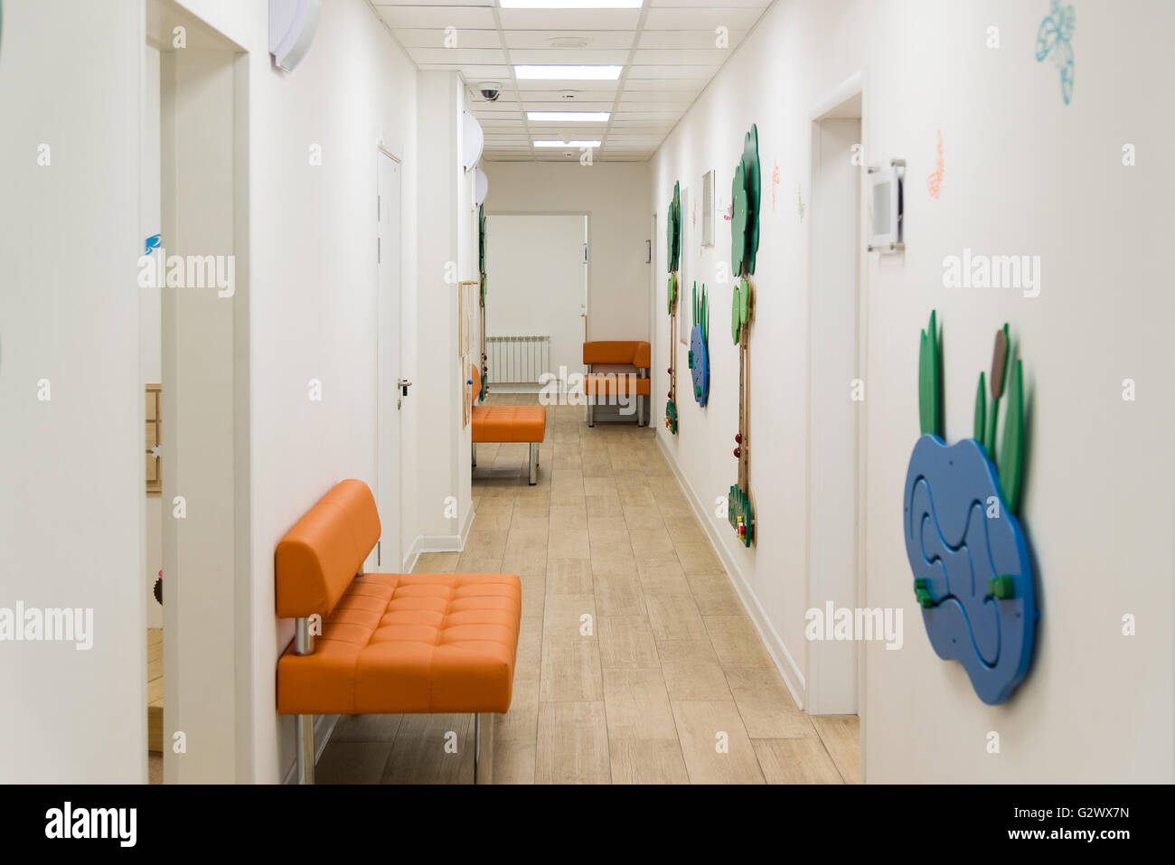 Children's Medical Center with educational games on walls - Stock Image