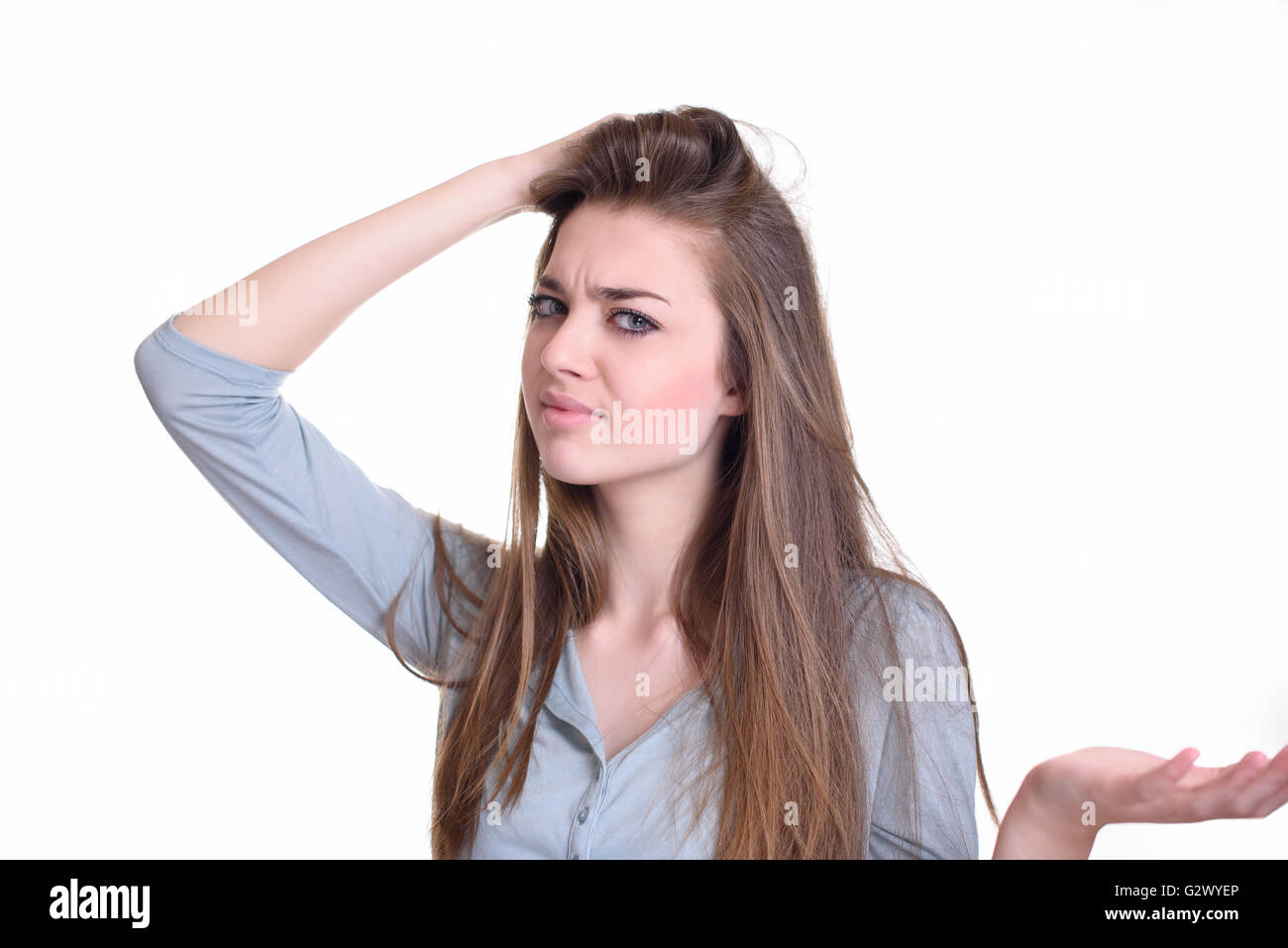 Confused young woman - Stock Image