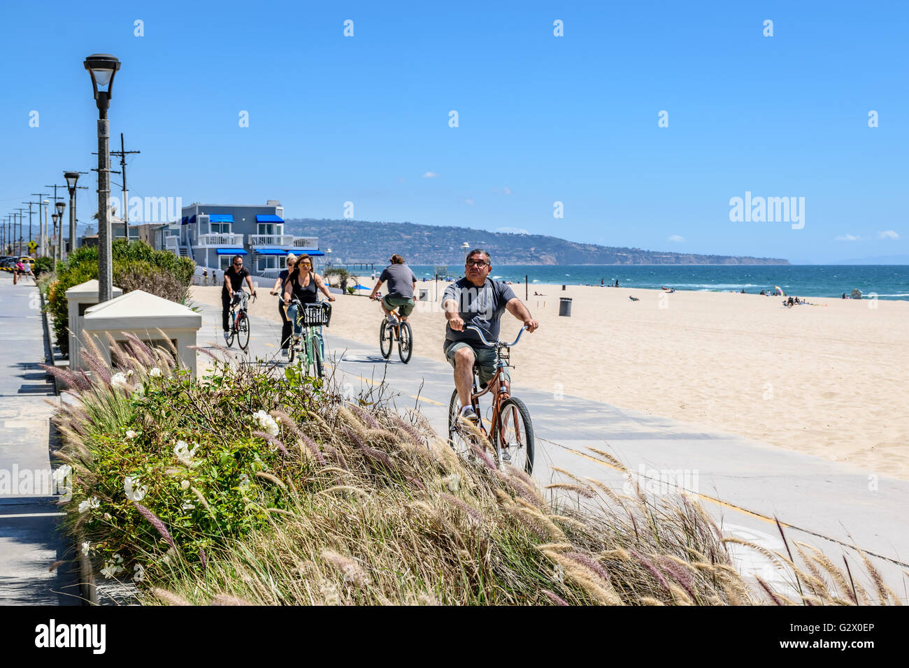 Recreation bicycle riders (cyclists) on the Manhattan Beach cycling path - Stock Image