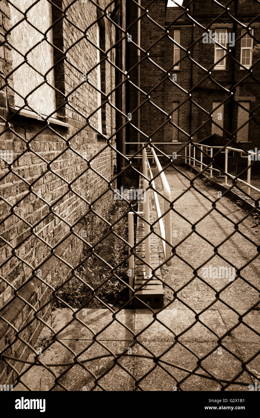 Fenced off building - Stock Image