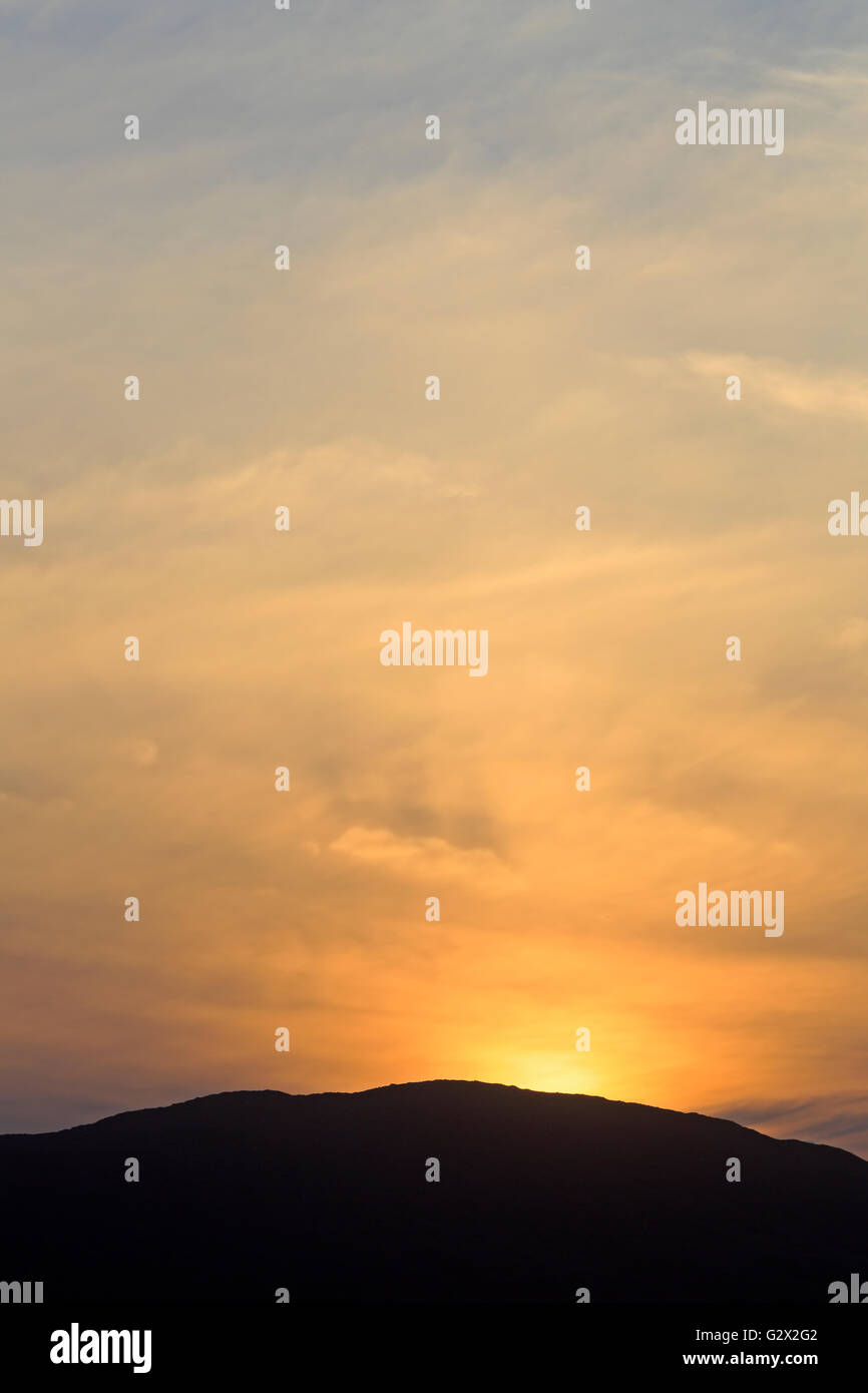 Sunset over the Isle of Taransay Outer Hebrides - Stock Image