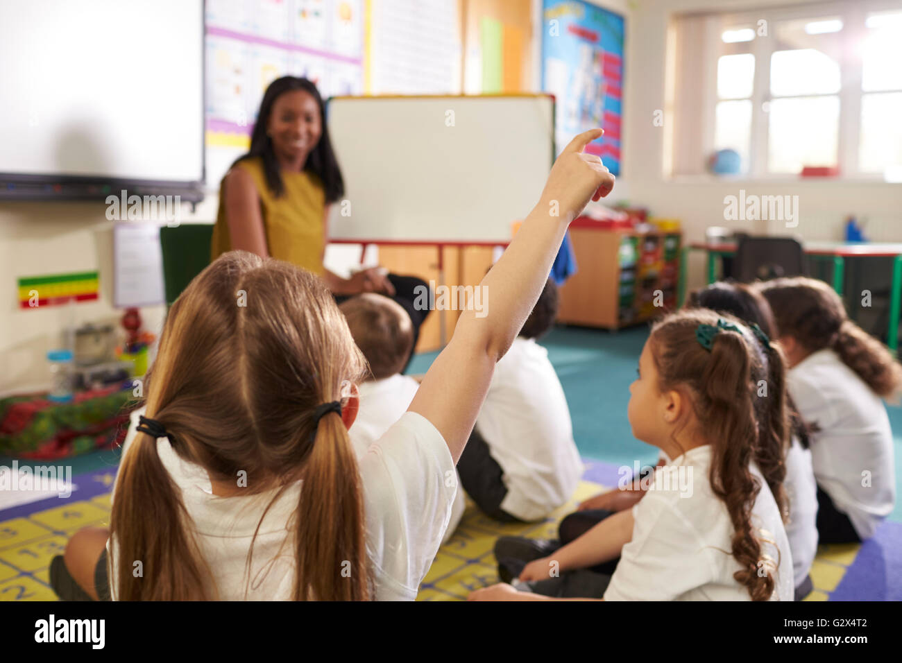 Teacher With Whiteboard In Elementary School Maths Class - Stock Image