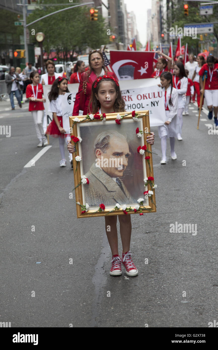 Young girl marches in the Turkish Parade in NYC with a portrait of Ataturk: Father of modern Turkey. Mustafa Kemal - Stock Image