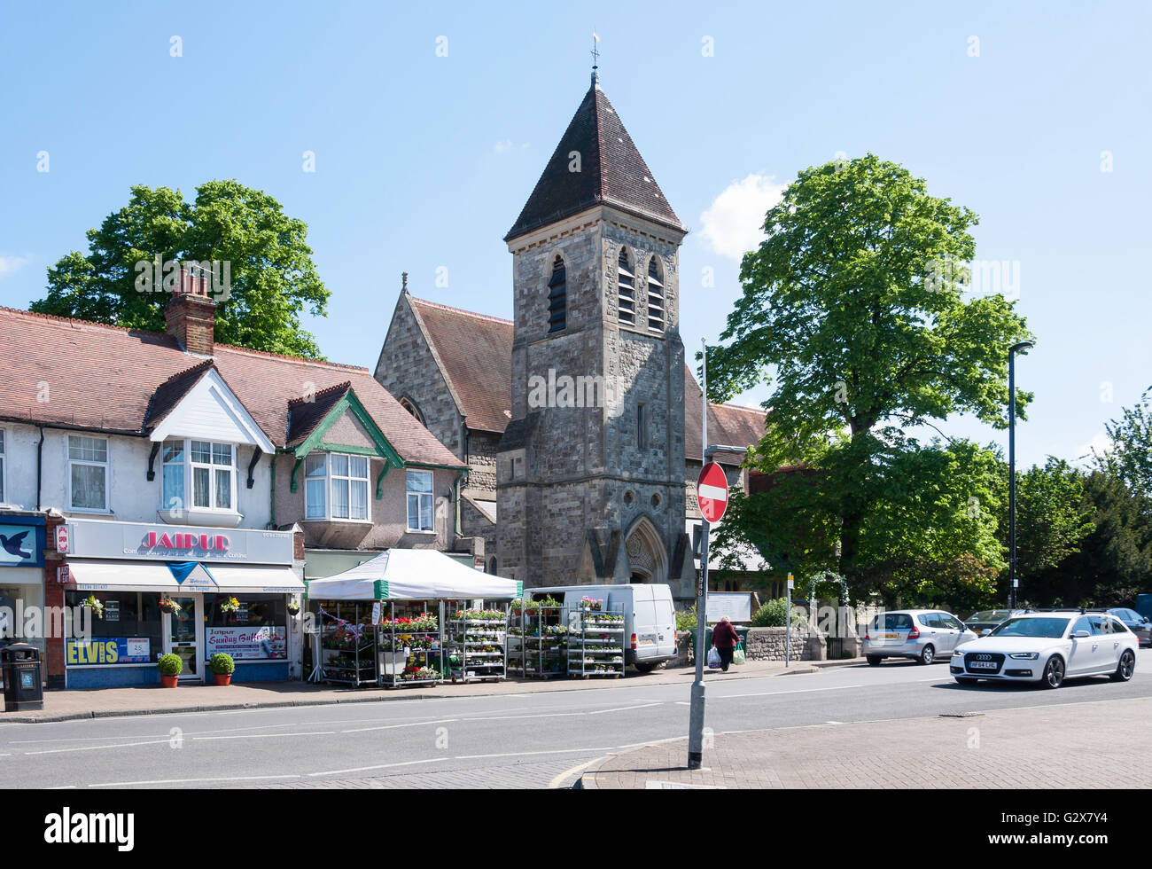 St Matthew's Church and shops, Church Road, Ashford, Surrey, England, United Kingdom - Stock Image