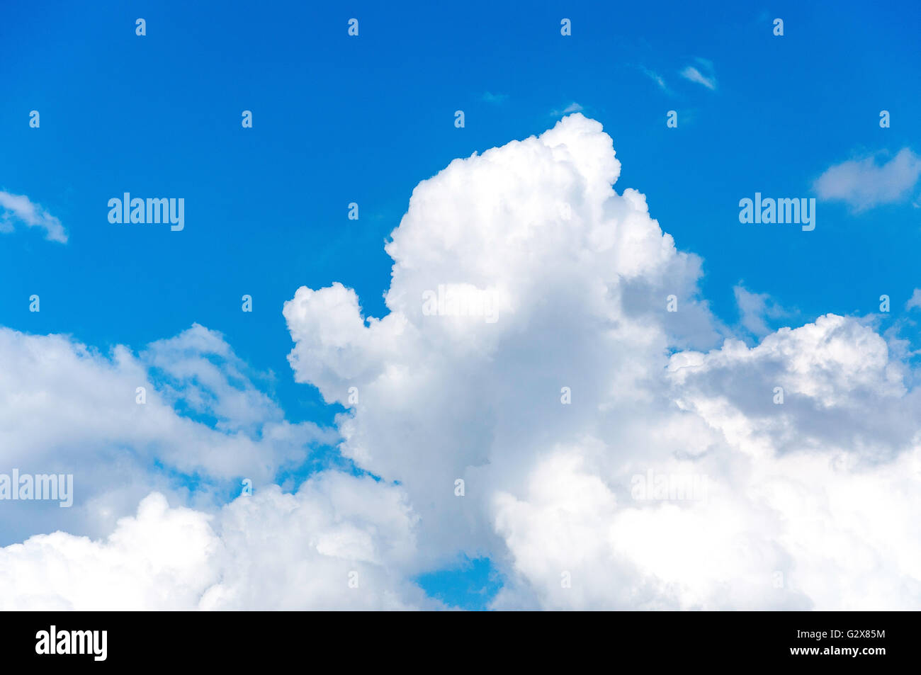 White cumulus clouds and blue sky, Surrey, England, United Kingdom - Stock Image