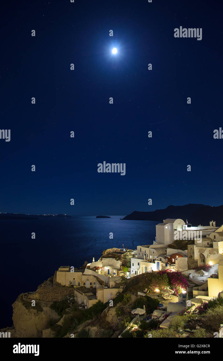 Starry night with a full moon over Oia, Santorini Greece - Stock Image