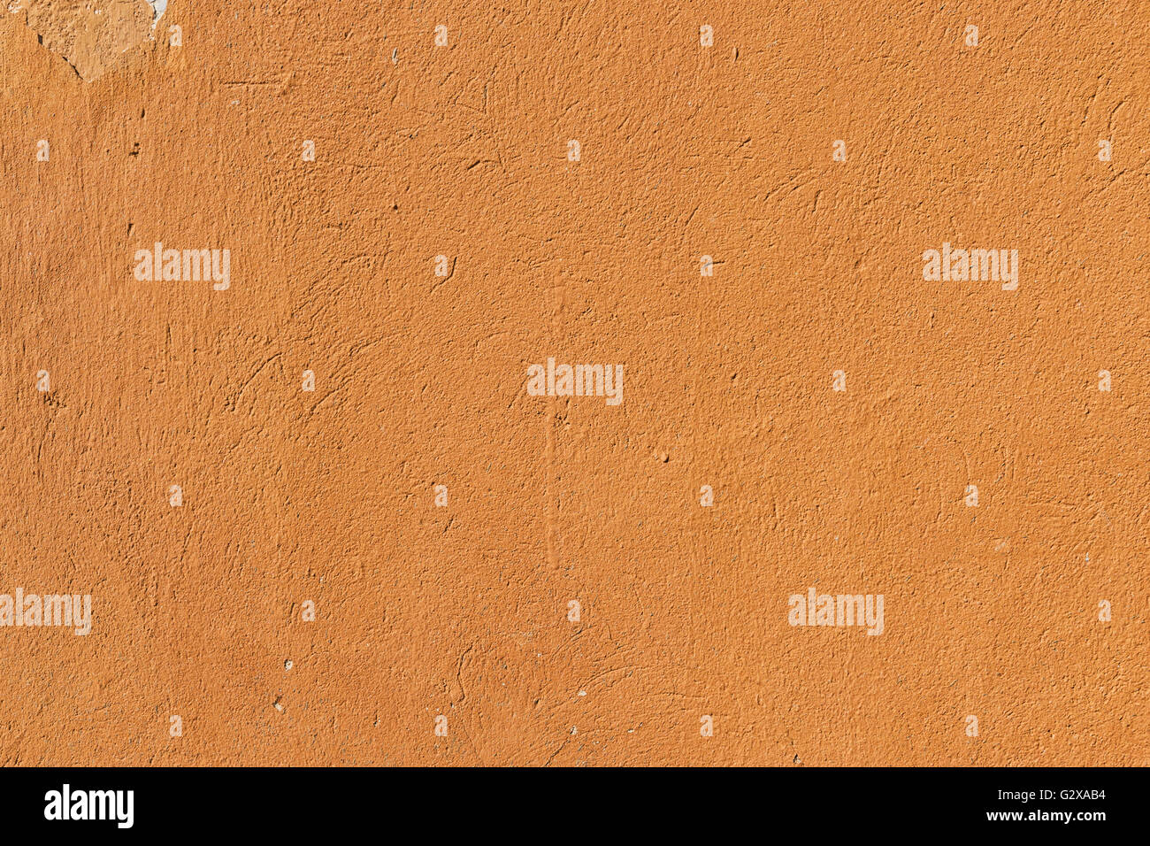 Details of a old concrete wall in orange color - Stock Image