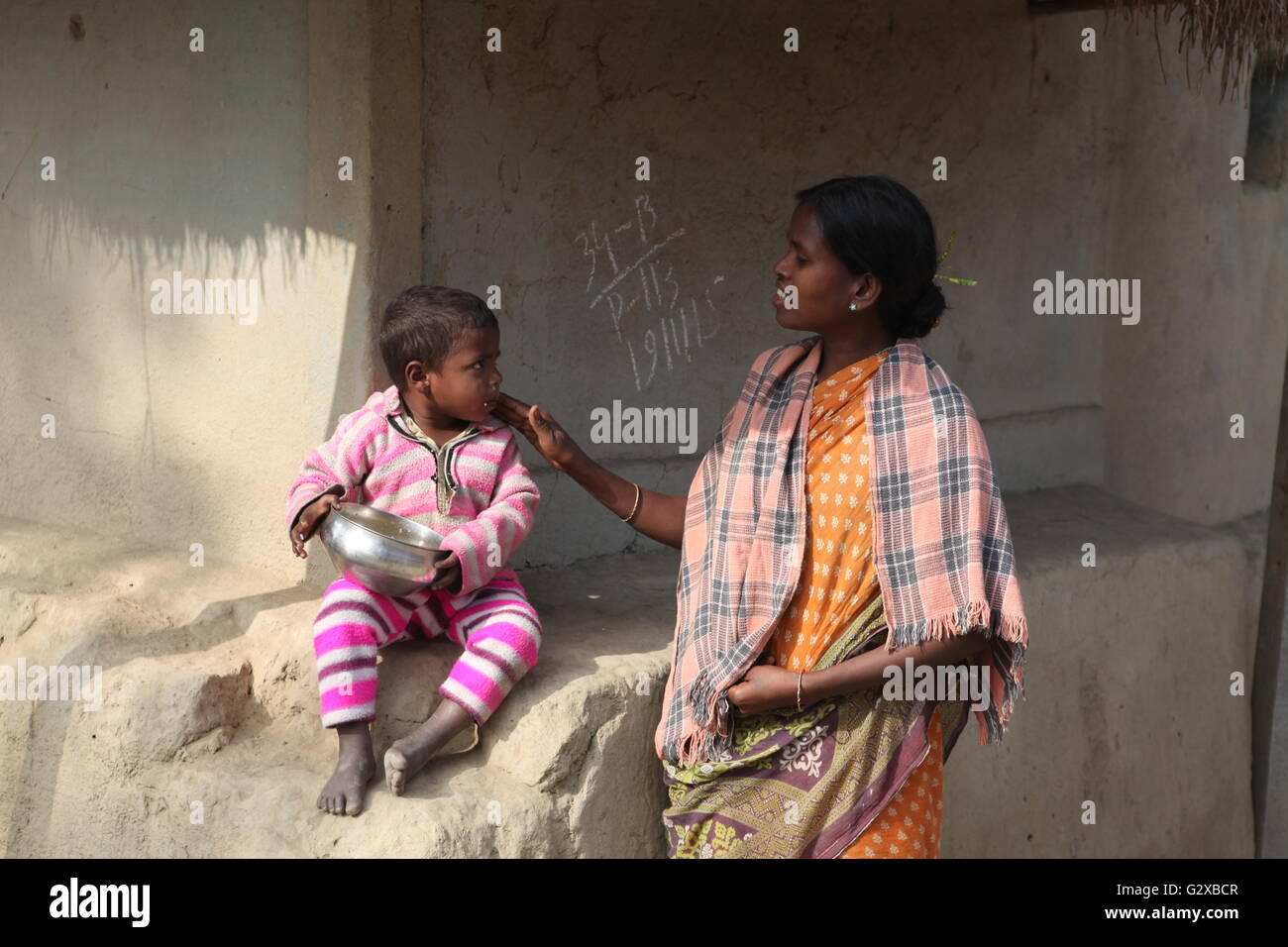a village woman caring her child in raiganj,west bengal - Stock Image