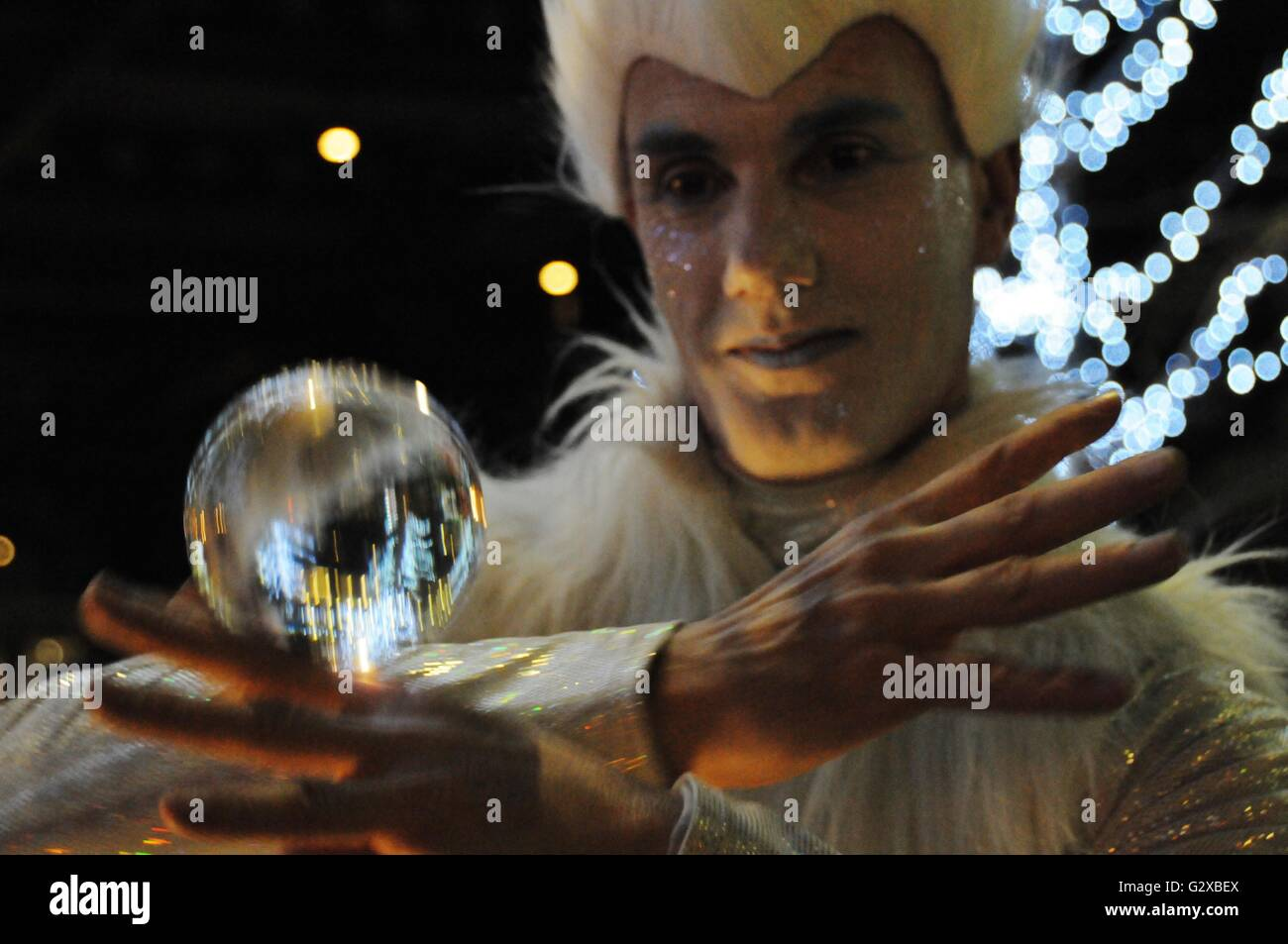 An entertainer rolls a ball across his arm, at the London Frost fair. - Stock Image