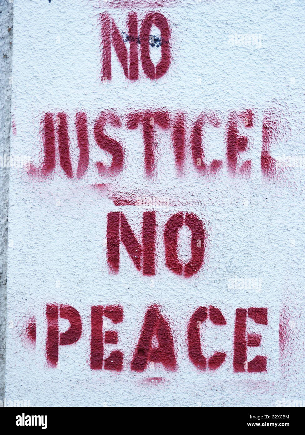 'No justice no peace', 'No justice, no peace' sponti graffiti slogan on a wall, Freiburg, Baden - Stock Image