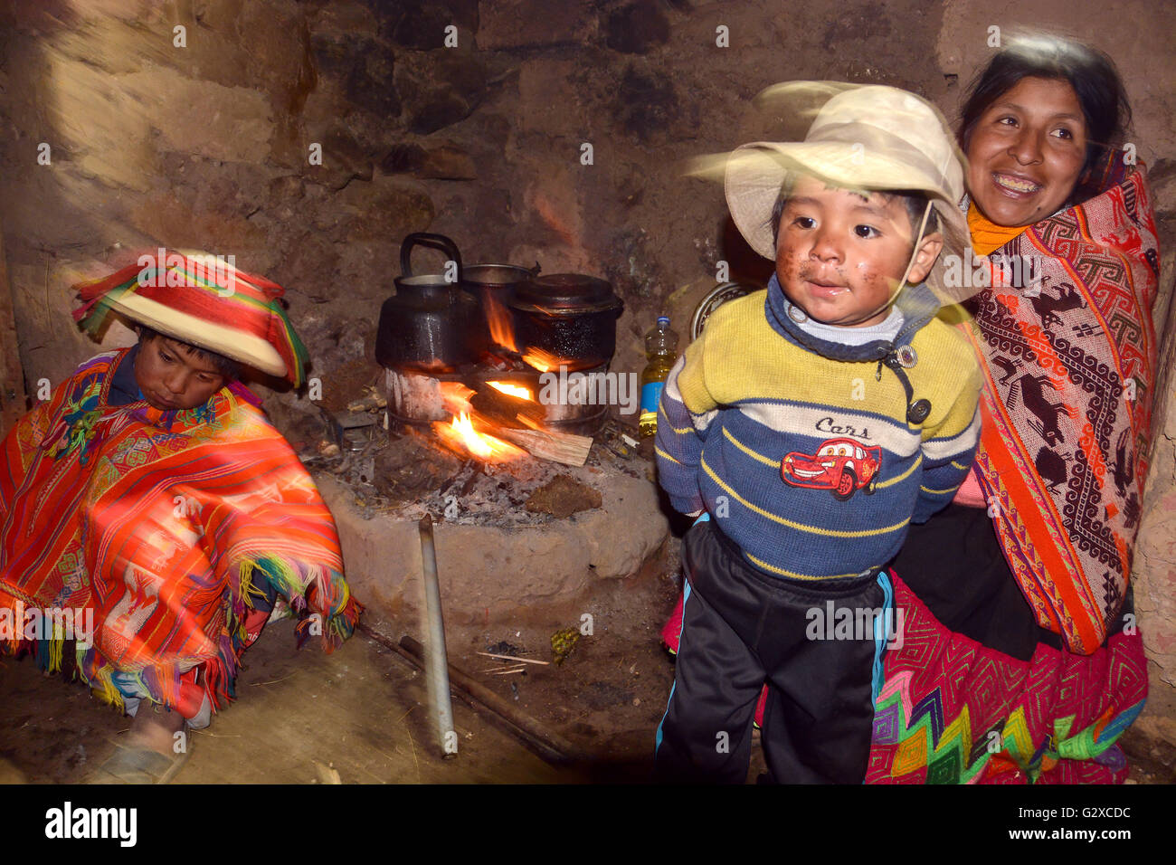 Indio Family At The Fireplace In Their Hut Andes Lares Near Cusco