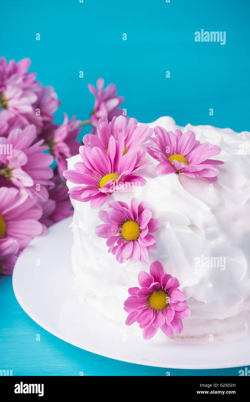 Blue flowers on wedding cake stock photos blue flowers on wedding white creamy cake with flowers on the blue wooden background stock image izmirmasajfo