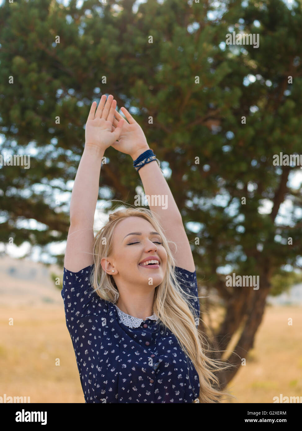Bright Portrait of Happy Woman at Summer Field - Stock Image