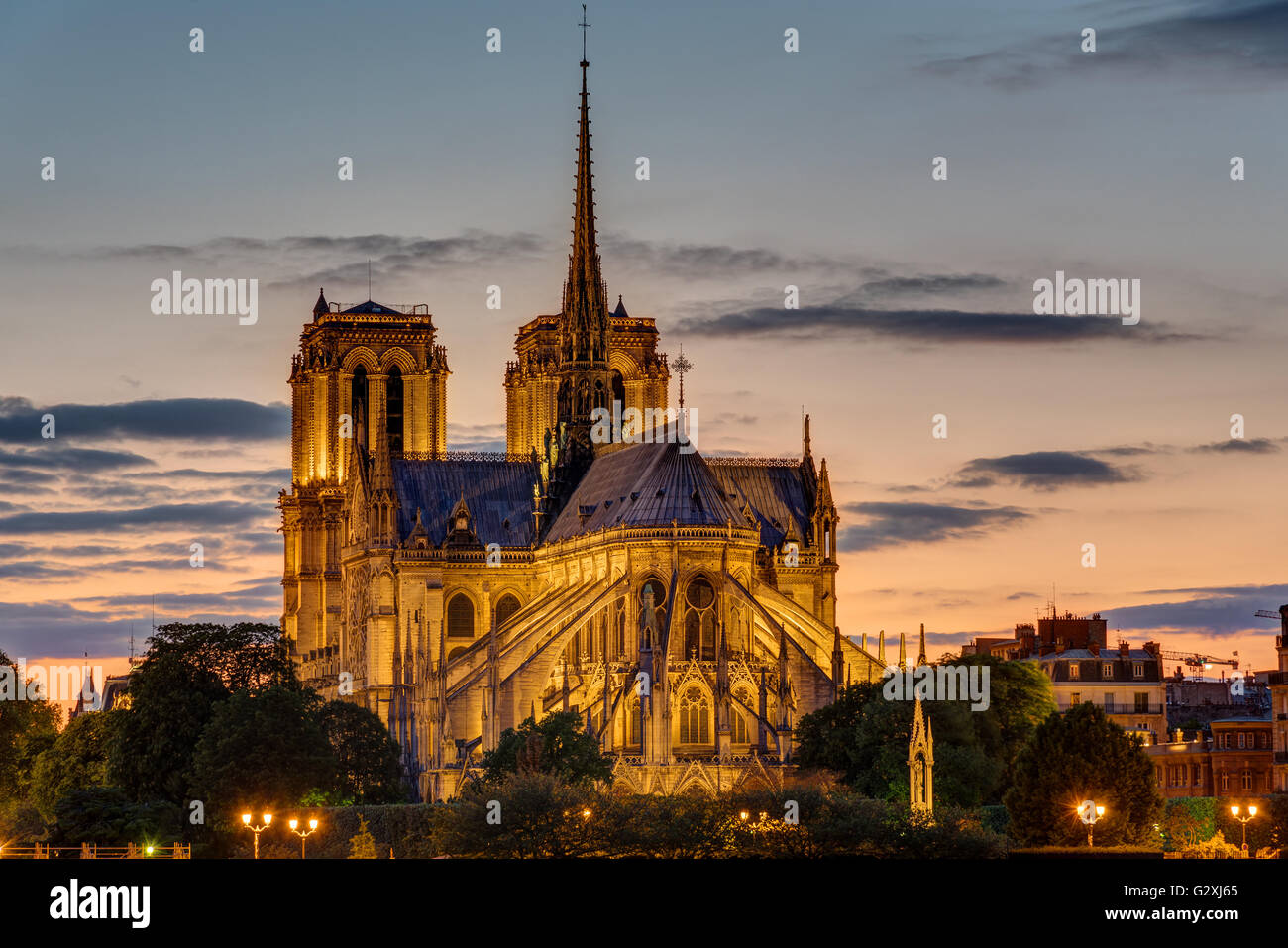 The backside of the famous Notre Dame cathedral in Paris at dawn - Stock Image
