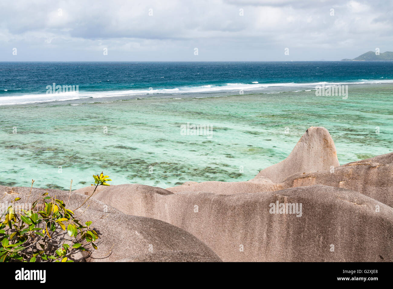 View from a large formation of granite rock at the famous Anse Source D'Argent in La Digue, Seychelles Stock Photo