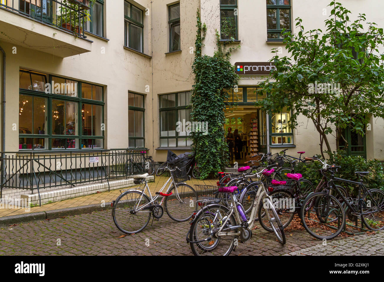 A collection of bicycles parked on a cobbled street Stock Photo
