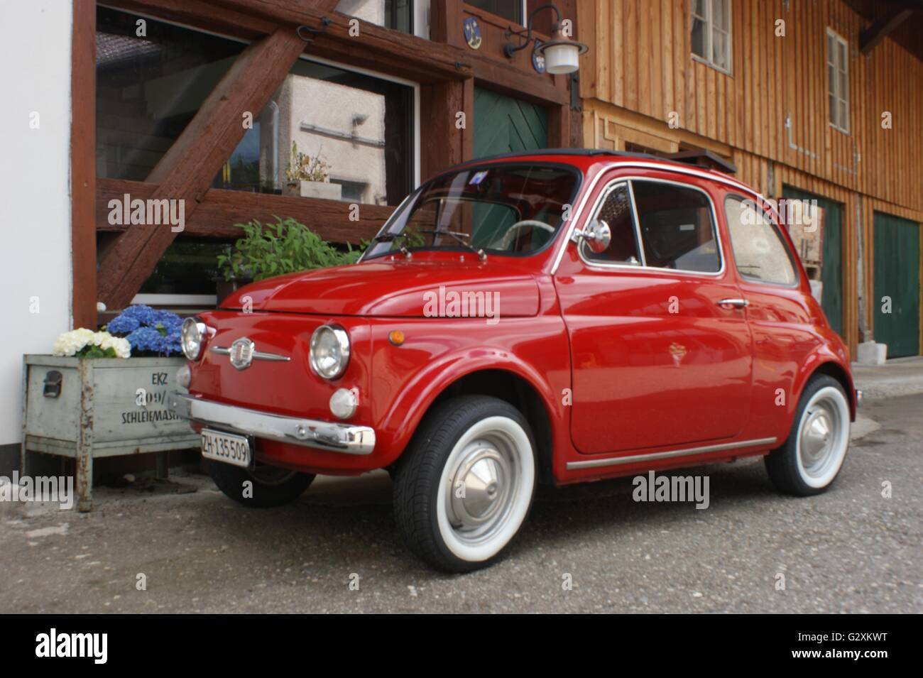 SONY DSC red 1960 Fiat 500 minicar, whitewall tires, in Switzerland, Canton Zurich, cute car, cute wheels, cute, - Stock Image