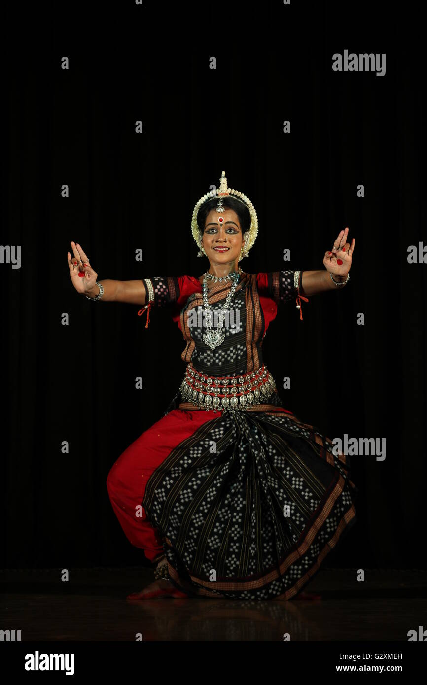 one of the classical dance forms of india,odissi is famous for it's graceful movements,costume,make up,head - Stock Image