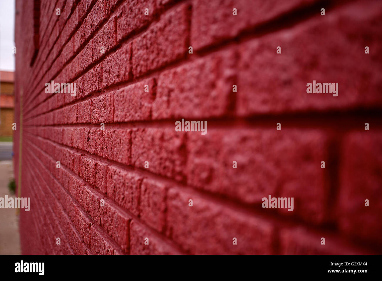 Abstract view of a painted red brick wall. Digital background or wallpaper with lines and tension. Stock Photo