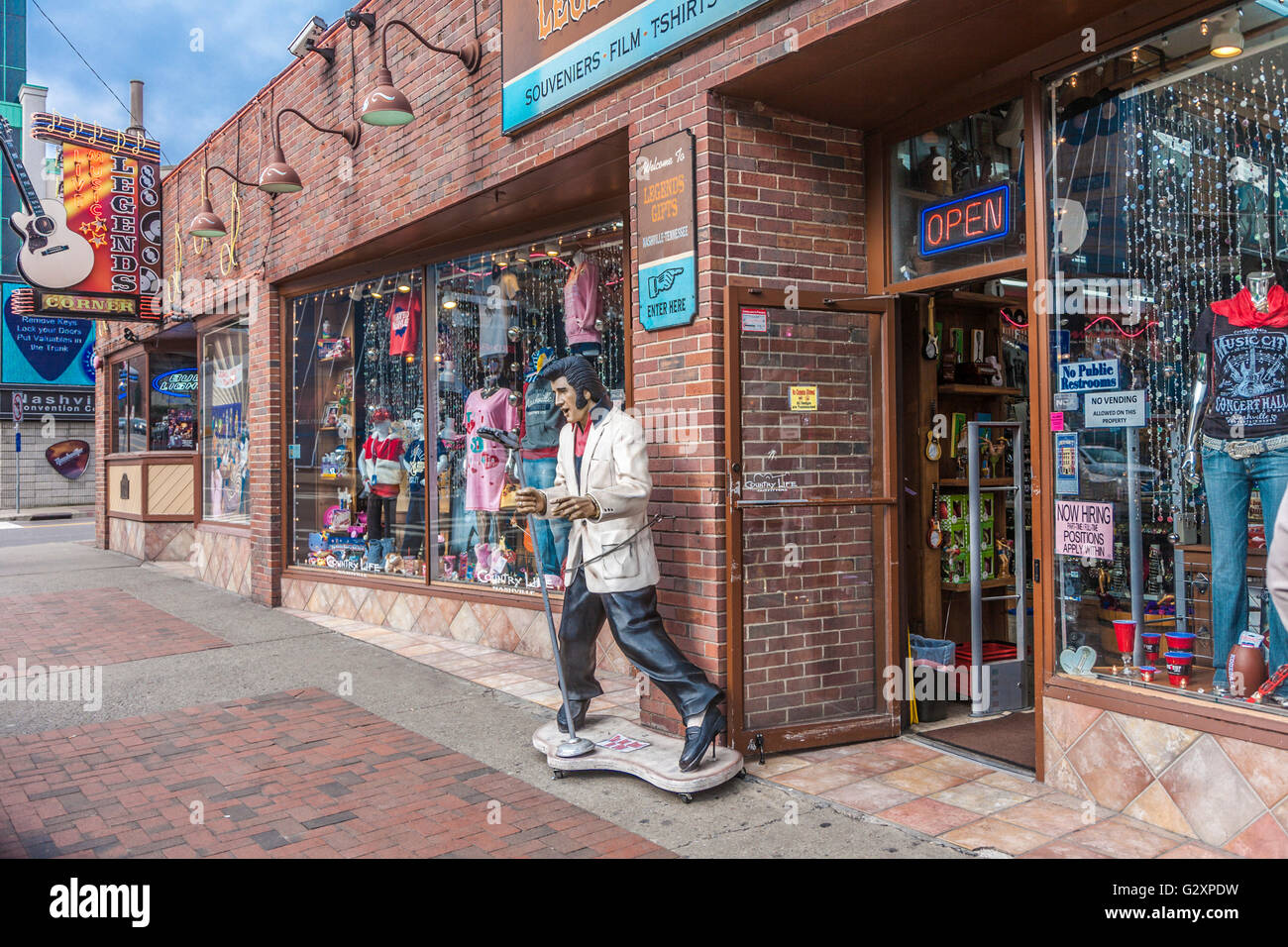 Statue of Elvis Presley on sidewalk outside of Legends Gifts store on Broadway in downtown Nashville, Tennessee - Stock Image