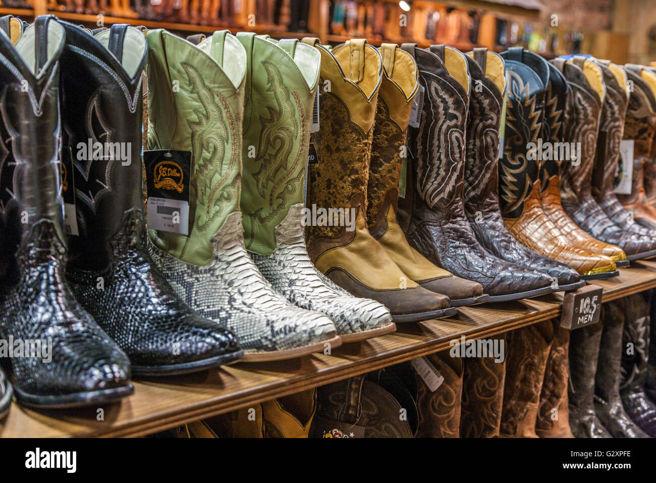 Large variety of cowboy boots for sale at boot store in downtown Nashville, Tennessee - Stock Image
