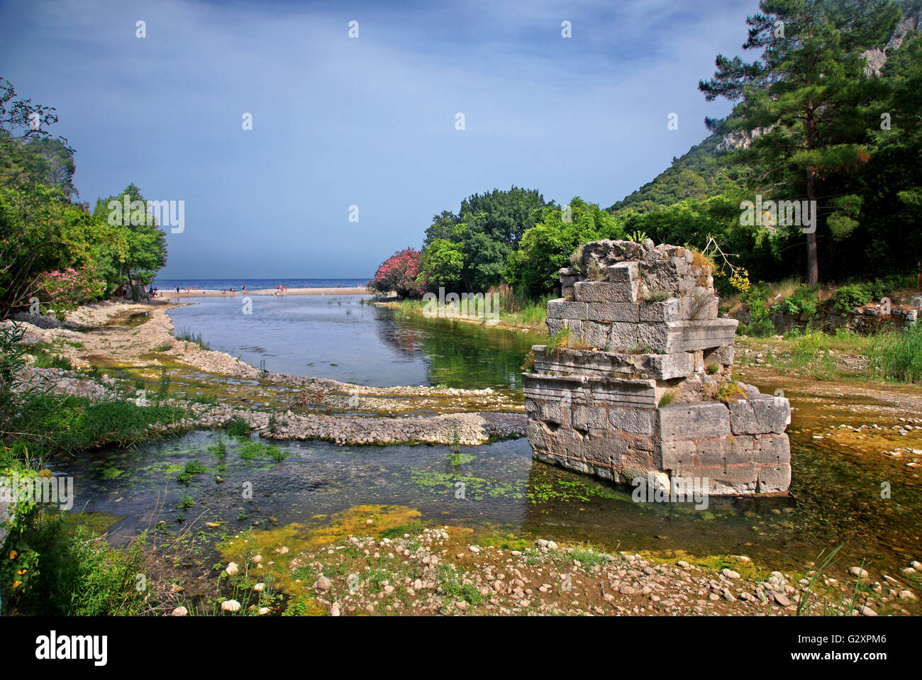 Ruins of an ancient (Roman) bridge at the archaeological site of Olympos, Lycia, Antalya province, Turkey. - Stock Image